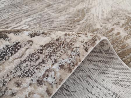Nowoczesny dywan Dizayn 6687 BEIGE. Brązowo beżowe barwy i regularny wzór podkreślą charakter Twojego pomieszczenia. Profesjonalne wykonanie oraz wysoka jakość, gwarantują długie użytkowanie produktu.