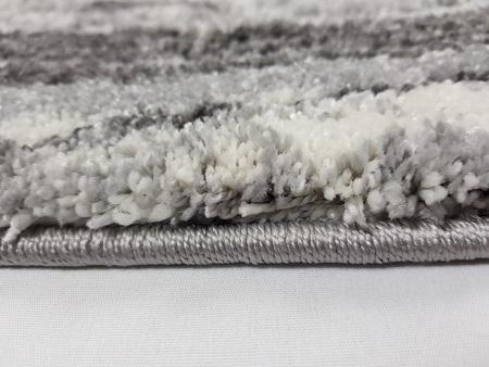 Nowoczesny dywan DELFIN 0178A GREY. Puszysty dywan - modny wzór, Niesymetryczne kształty w odcieniach brązu i beżu podkreślą charakter Twojego pomieszczenia. Profesjonalne wykonanie oraz wysoka jakość, gwarantują długie użytkowanie produktu.