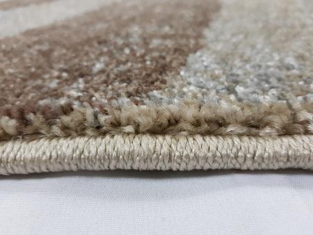 Nowoczesny dywan Adventure 50021-15055 BEIGE BROWN. Puszysty dywan - modny wzór. Niesymetryczne kształty w odcieniach brązu i beżu podkreślą charakter Twojego pomieszczenia. Profesjonalne wykonanie oraz wysoka jakość, gwarantują długie użytkowanie produkt
