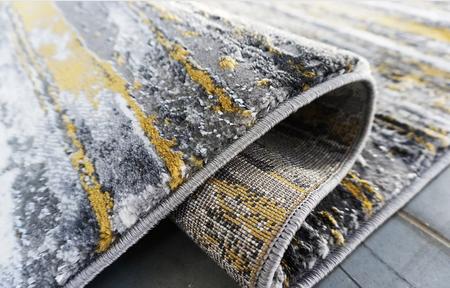 Nowoczesny dywan Zara 8488 YELLOW GREY. Grafitowo szare wzory podkreślą charakter Twojego pomieszczenia. Profesjonalne wykonanie oraz wysoka jakość, gwarantują długie użytkowanie produktu.